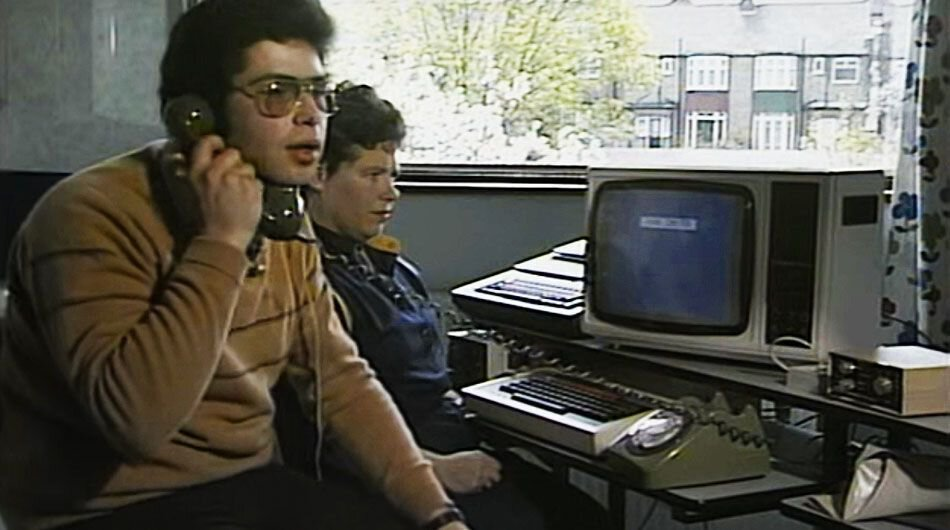 A user dials up an online connection before sending an email in 1984 (Source: ThamesTV)